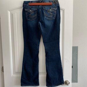 Silver brand Suki dark blue boot cut denim jeans.